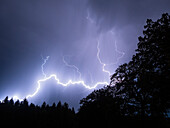 thunderstorm with lightning over forest, Bavaria, Germany, Europe
