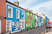 Colourful houses on Strand Street, the blue one featuring the popular Murphy's ice cream shop seen from while walking the Dingle Way, Dingle, Dingle Peninsula, County Kerry, Ireland, Europe