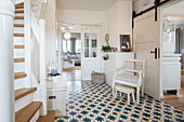 Entryway of modern Nordic Interior family house with white and gray furniture and antique tiled floor, Korbach, Hesse, Germany, Europe