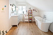 Bathroom with free-standing bathtub in modern familiy house with wooden floor, Korbach, Hesse, Germany, Europe