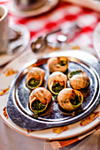 Escargots (snails) served on the table in La Mère Catherine restaurant, Place du Tertre, Montmartre, Paris, France, Europe
