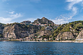 View from the water to the coast of Taormina, Sicily, South Italy, Italy