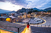 View to the Teatro di Antico of Taormina at the sunset with Etna and the Sea in the backround, Taormina, Sicily, South Italy, Italy