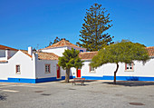 White house with red door at Porto Covo centre, District Setubal, Alentejo, Portugal, Europe