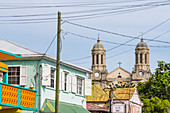 Street with old houses and the St. John's Cathedral , Saint John´s, Antigua and Barbuda, Caribbean, Lesser Antilles