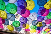 Umbrellas as a tourist attraction in Calle Fortaleza, Old Town, San Juan, Puerto Rico, Caribbean, USA