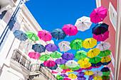 Umbrellas as a tourist attraction in Calle Fortaleza, Old Town, San Juan, Puerto Rico, Caribbean, USA