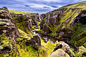Mossy green sides of Fjadrargljufur canyon in Iceland, Europe
