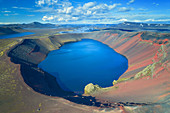 Aerial photograph of bright blue Ljotipollur crater lake in Iceland, Europe