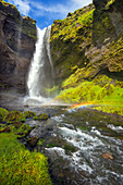 Kvernufoss waterfall in sunshine with rainbow: Iceland, Europe