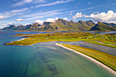 Aerial photograph of Moskenesoya island with Sandbotnen, Yttersand, Fredvang in Lofoten, Norway, Europe