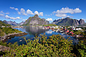 Harbour and cabins in Olstinden on Moskenesoya island, Lofoten, Norway, Europe