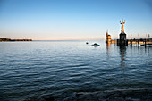 Pedal boat riders at the statue Imperia at Konstanz harbour, Lake Constance, Baden-Wuerttemberg, Germany