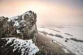 Bizarr rock formations at Ipf mountain (outlier) in winter with fog, Bopfingen, Ostalb District, Swabian Alb, Baden-Wuerttemberg, Germany