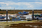Fishing boats at the nature reserve Ría Formosa, Conceicao Cabanas, Near Tavira, District Faro, Region of Algarve, Portugal, Europe