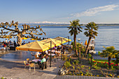 Restaurant in Meersburg on lake Constance with view over the lake to the Appenzell Alps in Eastern Switzerland, Meersburg, Baden, Baden-Wuerttemberg, South Germany, Germany, Central Europe, Europe