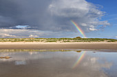 Rainbow over the beach in St. Peter-Ording, peninsula Eiderstedt, North Frisia, Schleswig-Holstein, Northern Germany, Germany, Europe