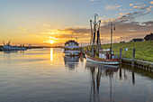 Sunrise above the harbour of Greetsiel, North Sea, East Frisia, Lower Saxony, Northern Germany, Germany, Europe