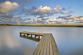Clouds and jetty at the Katrevel in Morsum, North Frisian Island Sylt, North Sea coast, Schleswig-Holstein, Northern Germany, Germany, Europe