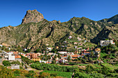 Houses and palm gardens of Vallehermoso with Roque Cano, La Gomera, Canary Islands, Canaries, Spain