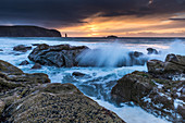 Sunset at Sandwood Bay, spray splashes over rocks, Highlands, Scotland, UK