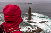 A female wanderer looks out over the Am Buachaille, Sandwood Bay, Highlands, Scotland, UK