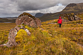 A female walker at Cul Beag, Inverpolly Nature Reserve, Highlands, Scotland, UK