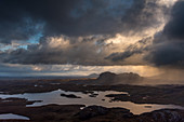 Rain showers over Suilven, Inverpolly Nature Reserve, Highlands, Scotland, UK