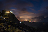 Arrival at the Watzmannhaus at dusk, view of the valley and city lights, Berchtesgaden Alps, Berchtesgaden, Germany