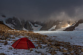 Bivouac at the Circo de los Altares, Cerro Torre in clouds, Los Glaciares National Park, Patagonia, Argentina
