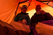 Climber and mountaineer in a tent at the Circo de los Altares, Los Glaciares National Park, Patagonia, Argentina