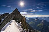 Climber on a ridge at Dome de Rochefort, Grandes Jorasses, Mont Blanc group, France