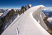 Climbers at a crosswalk, ridge at Dome de Rochefort, Grandes Jorasses, Mont Blanc group, France