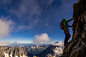 Climber on the ascent to the ridge of the Grandes Jorasses, Mont Blanc group, France