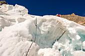 Climber before rappelling on ice break, Grandes Jorasses, Mont Blanc group, France