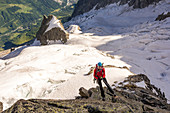 Mountaineer abseiling, view of the Val Ferret, Grandes Jorasses, Mont Blanc group, France