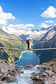 The tibetan bridge near Olperer refuge with Lake Schlegeispeicher on the background, Zillertal Alps, Tyrol, Schwaz district, Austria.