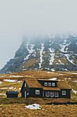 Iconic wooden house with grass roof, Gasadalur, Vagar island, Faroe Islands, Denmark