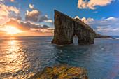 Sunset over the ocean and rock formation of Drangarnir, Vagar Island, Faroe Islands, Denmark