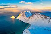 Aerial view of Haukland beach after a snowfall, Vestvagoy, Nordland, Lofoten Islands, Norway