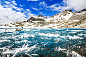 Ice crystals on surface of Lej da la Tscheppa during spring thaw, St. Moritz, Engadin, canton of Graubunden, Switzerland