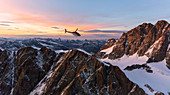 Aerial view of helicopter in flight towards Piz Roseg at sunset, Bernina Group, border of Italy and Switzerland