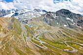 Aerial panoramic of winding road of Stelvio Pass, Braulio Valley, Valtellina, Lombardy, Italy