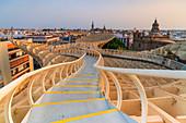 Spiral shape curved footbridge of Metropol Parasol (Setas de Sevilla), Plaza de la Encarnacion, Seville, Andalusia, Spain
