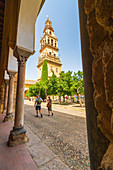 Tourists in the portico front of the tower of Mezquita-Catedral (Great Mosque of Cordoba), Cordoba, Andalusia, Spain