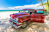 Classic American vintage car on the tropical beach of Cayo Jutias, Pinar del Rio Province, Cuba