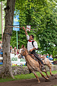 Castelrotto / Kastelruth, South Tyrol, Italy. The traditional ring jousting at the Mount Calvario in Castelrotto