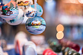 a detail of hand painted Christmas balls into the traditional Christmas Markets in South Tyrol, Bolzano province, Trentino Alto Adige, Italy