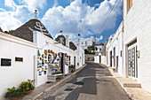 View of the typical Trulli huts and the alleys of the old village of Alberobello. Province of Bari, Apulia, Italy, Europe.