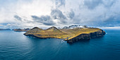 Aerial panoramic view of Eysturoy island from the sea in front of Gjogv village (Faroe Islands, Denmark)